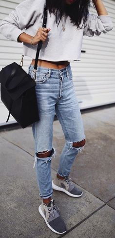 crop sweatshirt. ripped jeans. sneakers.