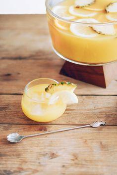 Spicy Pineapple Punch Cocktail --1 oz American Honey Whiskey, 3/4 oz American Honey Sting, 1/2 oz Appelton Estate Rum, 1/2 oz apricot brandy, 3 oz pineapple juice, 1 oz lemon, 1 oz orange juice, dash bitters, pineapple & lemon garnish.