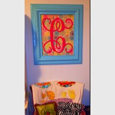 Frame- found at thrift store and re-painted, wooden letter, foam board and scrapbook paper!