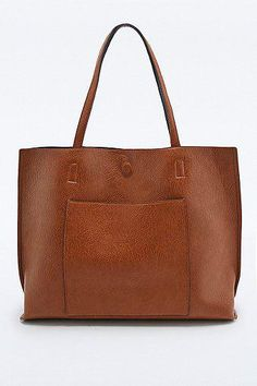 Love my new handbag I got for my birthday! Reversible Vegan Leather Pocket Tote Bag in Tan and Black - Urban Outfitters #handbag #bag #women #accesories #covetme