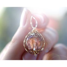 Glitter Sunstone necklace, glowing orb infinity necklace, girlfriend... ($29) ❤ liked on Polyvore featuring jewelry, necklaces, infinity jewelry, infinity necklace, infinity jewellery, glitter jewelry and glitter necklace