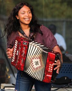 Rosie Ledet born October 25 1971 Mary Roszela Bellard in Church Point Louisiana USA is an American Creole Zydeco accordion player and singer Rosie Lede Louisiana Creole, Accordion Music, New Orleans Music, Folk Music, Sound Of Music, Musicals, Blues, Instruments, Pin Up Girls
