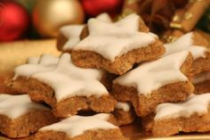 Zimtsterne - One of the most delicious cookies I have ever eaten! A simple German almond-cookie recipe that will be a hit at every holiday party!