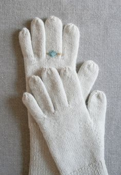 Because there was a time when ladies didn't leave the house without  them, gloves have always suggested to me the elegance of horse-drawn  carriages, drawing rooms and balls. I have long imagined knitting a fine  pair of gloves that would be as appropriate for that life as this one.  A simple cuff that can be worn long or folded, a thumb gusset and  fingers  that fit your own, the result is a classic pair of gloves.  Perhaps they're the sort that could have been worn by the tragic Lily  Bart…