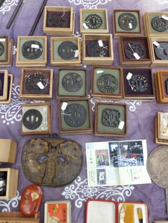 A collections of tsuba (sword guards) on sale at the Oedo Antique Markets, Tokyo