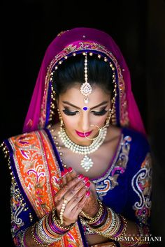 Indian bride wearing bridal lehenga and jewelry. Indian Bridal Hairstyle. Indian Bridal Makeup. Indian Bridal Fashion. Bridal Photoshoot.