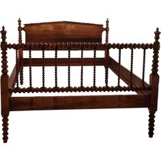 This gorgeous bed frame is a true Jenny Lind style spindle bed, with angled corners and beautiful dark wood. mid 1850's. This looks the closest to what I remember GGMom Lydia's beds looking like, but in a twin.