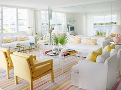 Sunny Parsons chairs and graphic pillows