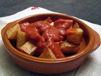 Bravas Potatoes - Patatas Bravas (c) - Fried potatoes with hot sauce...a popular tapas in Spain