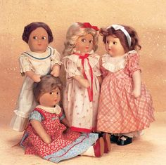 "Very Rare Earliest-Version Cloth ""Little Women"" by Madame Alexander with Original Costumes - the first version of the Little Women dolls,appeared in 1933-34,and coinciding with the RKO release of the film,Little Women,with Katherine Hepburn. Each of the dolls wears its original costume,shoes and socks,and undergarments,and three of the four costumes (Meg,Jo and Amy) are tagged with name of doll and ÒLittle Women. Very rare early dolls,especially rare to find as entire set."