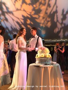 A beautiful bride and groom with their wedding cake, on the dance floor of their sailcloth tent. Lighting by Seitel Lighting LLC Wedding Tent Lighting, Tent Wedding, Wedding Cakes, Wedding Dresses, Sailing Outfit, Beautiful Bride, Groom, Flower Girl Dresses, Dance