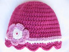 Pattern for quick crocheted baby hat with shell edging and pink flower