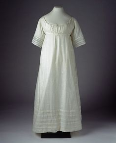 1804    Muslin Dress, British. White cotton dress with multi levels of trim on hem and sleeves. High waisted and simple fall skirt, short straight sleeves, scooped neckline.  via MuseumofLondon.org suzilove.com