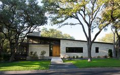 Tim Cuppett Architects built this mid century looking home in a neighborhood that was predominantly mid century architecture. At first glance I thought