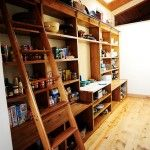 I so desperately need this pantry.  And I want that rolling ladder