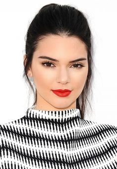 The juxtaposition of Kendall's smooth, creamy pale complexion and her bold red lip is one of the most gorgeous looks we've seen on the model. For your own fire-engine-red lip, try Revlon Super...