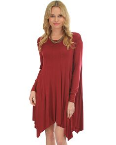 This dress creates a flirty look with its flowing cut and handkerchief hem, making it an ideal outfit for a cocktail party or dinner date. - 95% Rayon, 5% Spandex - Runs true to size - Model is wearin