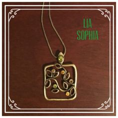 Necklace This adjustable necklace features bronzed square with beautiful branch and leaf designs. Green, pink and orange rhinestones add to the necklace and provide a sparkle when worn! Lia Sophia Jewelry Necklaces