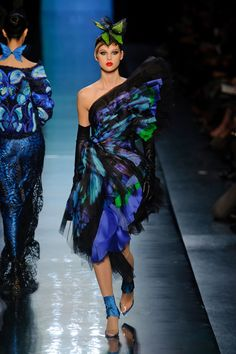The butterfly-themed show from Jean Paul Gaultier Haute Couture Spring 2014 included haute headpieces, soft fabrics, lots of netting and some of the most striking colors seen on a runway in recent memory. Proving, once again, one of the most daring and brilliant artists of fashion.