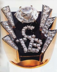 """ELVIS PRESLEY'S RING - TCB, framed with lightning bolts - """"Taking Care of Business"""" in a flash."""