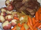 This is the best pot roast I have ever made! It does pay off to sear your roast if you have time to (I cooked the in the oven.) I did this without adding the potatoes since I made the scalloped potatoes with it. I did add the carrots. Also, instead of taking the meat out of the pot to make the roux, I moved the roast to the side of my dutch oven and mixed the flour right into the beef juices which made a mouth watering gravy and then I let it cook on the stovetop for about 15 minutes.