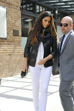 Camila Alves breaks u her all white look with a gray scarf and black leather jacket