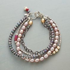 """INSPIRED ELEGANCE BRACELET--Pale blush, soft gold and gray peacock pearls, sterling silver and ruby roundels come together in a three-strand bracelet combining whimsy and elegance. Sterling silver clasp. USA. Exclusive. Approx. 7-1/2""""L."""