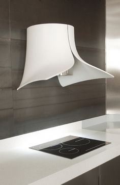 This is the 1st time we have seen Corian used as an extractor...AMAZING, we hope this inspires a few more people :)