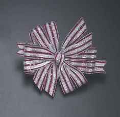 A Ruby and Diamond Bow Brooch.