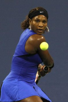 Serena Williams, legendary tennis player with her eyes on the ball (2011 US Open)
