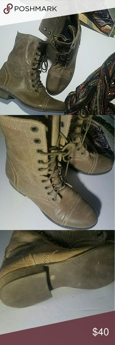 Steve Madden Troopa Boot Stone Color Vintage inspired combat boots  Side-zip closure with lace-up front. Leather upper with classic stitch detail. Cap toe. Leather lining. Lightly cushioned leather footbed. Rubber sole. Heel Height: 1 in Circumference: 12 in Shaft: 8 in Steve Madden Shoes