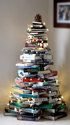 "If you don't have a Christmas tree to decorate, you can still get into the holiday spirit. Try stacking your books into a Christmas tree! The ""tree"" in the picture took about 80 books to complete, so you can gauge how big or small you want your ""tree"" to be. Merry Christmas!"