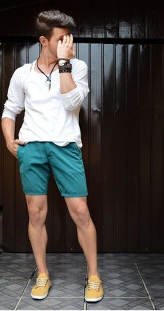 Shop this look on Lookastic:  http://lookastic.com/men/looks/white-long-sleeve-t-shirt-teal-shorts-yellow-plimsolls-dark-brown-bracelet/11364  — Dark Brown Leather Bracelet  — White Long Sleeve T-Shirt  — Teal Shorts  — Yellow Canvas Plimsolls