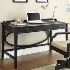 "Three-drawer desk with an open oval accent.  Product: DeskConstruction Material: MDFColor: BlackFeatures: Three drawersDimensions: 31.5"" H x 51.5"" W x 27.5"" D"