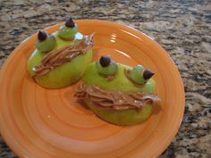 Cooking in the classroom...apple frog made with green apple slices, peanut butter (or could use cream cheese or frosting), green grapes, and chocolate chips