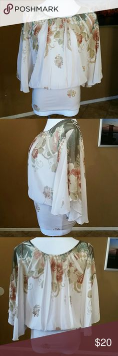 Lovely blouse Beautiful floral pattern. Stretchy waist, which lays flat at 14.5 inches before stretching. Armpit to armpit is impossible to measure. 100% Polyester Bloom Tops Blouses