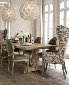 Love the contrast of the wing and side chairs. Table's awesome, too!