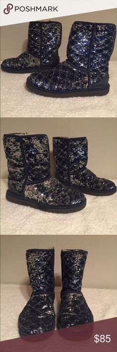 UGG Navy Silver reversible sequin boots Sz 8 Beautiful navy and silver reversible sequin Uggs. Boots are a short rise. Used and show some wear but are in very good condition with lots of life left. Women's size 8 UGG Shoes Winter & Rain Boots
