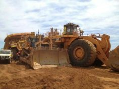 Cat power! Dozer and wheel loader pulling a big quarry dump truck from distress...