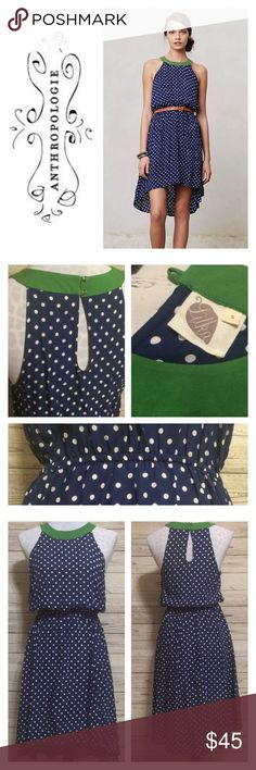 """Anthropologie Polka Dot Dress Navy and white polka dot dress by Lilka for Anthropologie has an expected pop of color with its contrasting Kelly green neckline. Pullover styling with two small buttons at the back of neckline. High low styling with an elastic waist. Flawless condition. Measurements lying flat: Bust= 17"""". Waist = elastic that stretches to max 20"""". Length of front = 36"""". Length of back= 43"""". Anthropologie Dresses"""
