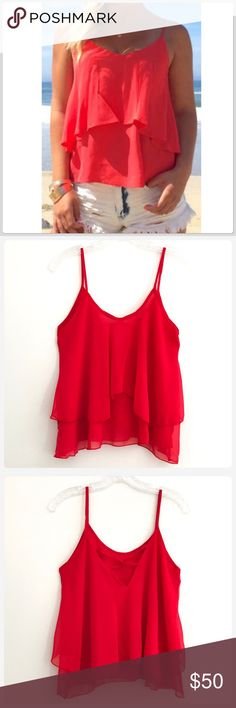 NWT Fiery Red Ruffled Adjustable Camisole Top JUST IN! This a a gorgeous bright red flowy top! The straps are adjustable, and the ruffles are just adorable! This top is so versatile for the spring and summer! Size Large Bust 18 Length 23.5 Boutique Tops Camisoles