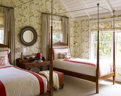 Loving the bold wallpaper  canopy beds in this country/cottage bedroom by Mendelson Group #interiordesign