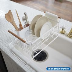 The fresh, clean lines of the Tosca collection make this dish rack an easy choice for after-dinner cleanup. Its steel body holds plates and drinkware while a removable cutlery holder keeps utensils upright while drying. The bottom rack slides over your sink allowing contents to drip dry without taking up countertop space. Wood-trimmed handles can even double as towel racks so dish cloths can air-dry fast. Interior Modern, Home Interior, Coastal Interior, Interior Design, Kitchen Interior, Home Design, Diy Kitchen, Kitchen Decor, Kitchen Ideas