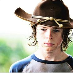 "Carl... I didn't like him at first.  He was a snot-nosed kid that never listened to anyone.""Stay in the house Carl!"" But he's become one of my favorite characters in the last two seasons because he's grown so much and matured because of what he's had to do to survive... can't wait for season 5."