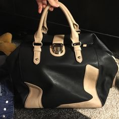 Bag perfect size for an over night! Used once Black and brown bag that is a perfect size for an over night! Zips closed, and has a clasp. Two deep zipper pockets. JustFab Bags Mini Bags