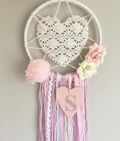 Make your little girls dreams come true, whilst catching the bad ones, with this one of a kind Sweetheart Dream Catcher. Fill their room with love with this heart centered piece whilst making it that touch more personal with an initial of your choice. Measurements: 6inch hoop/25-30cm