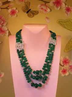 Emerald and diamond set, in this multi-strand oriental style necklace,  which was inspired by  the Le Bal Oriental,  Van Cleef and Arpels. Diamonds and Rhubarb ®