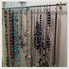 Cheap curtain rod+ metal S hooks= An Awesome Necklace Holder!!