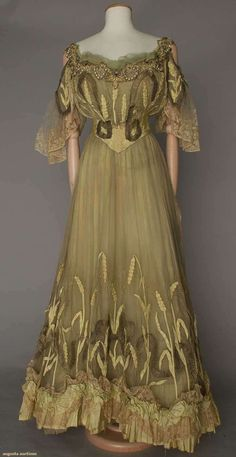 ca 1900 pale celery colored silk and organdy evening gown with beads, pearls and saphirette stones embellishing the neckline.