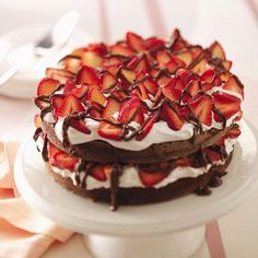 Chocolate Strawberry Torte        I made this one year for my father-in-law's birthday, and it was a big hit. I've since made it for Easter and other spring occasions.—Paula Magnus, Republic, Washington      10-12 ServingsPrep: 20 min. Bake: 30 min. + cooling      Ingredients  5 ounces semisweet chocolate, chopped  3/4 cup butter, cubed  1-1/2 cups sugar  3 eggs  2 teaspoons vanilla extract  2-1/2 cups all-purpose flour  1 teaspoon baking soda  1/4 teaspoon salt  1-1/2 cups water  STRAWBERRY...